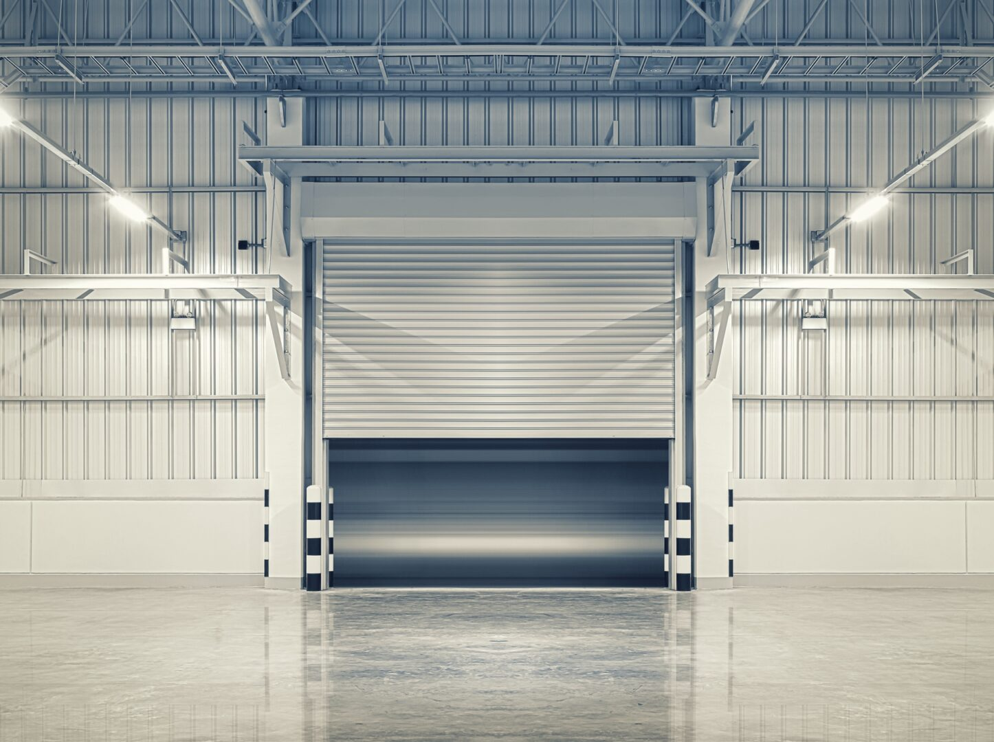 Roller door or roller shutter using for factory, warehouse or hangar. Industrial building interior consist of polished concrete floor and half open door for product display or industry background.